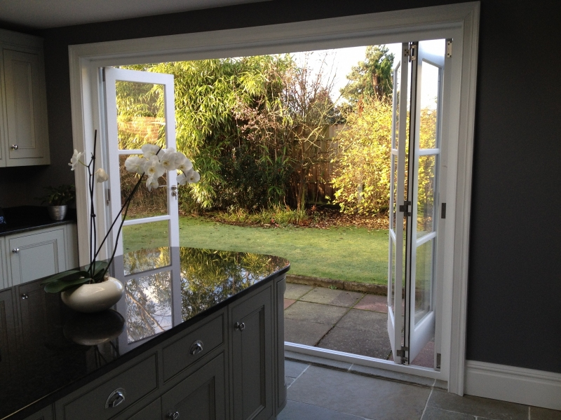 Hand-made bi-fold doors opening to patio area